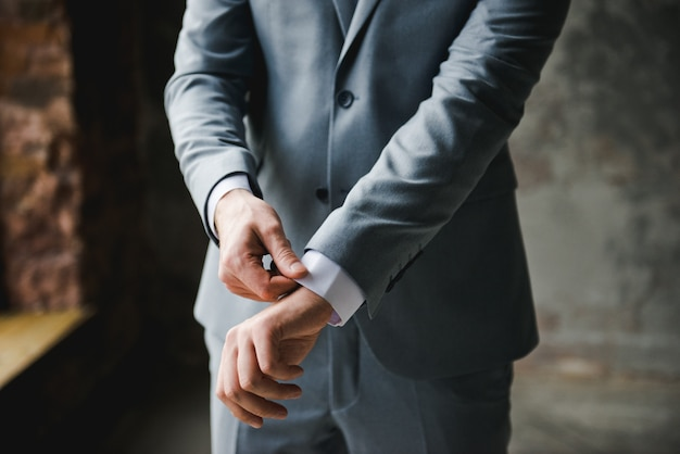 Morning of the groom. groom morning preparation. young and handsome groom getting dressed Premium Photo