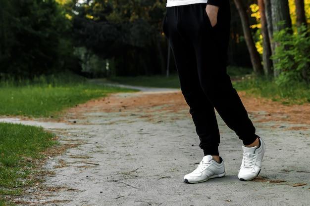 Morning jog in the park, men's legs close-up copy space Premium Photo