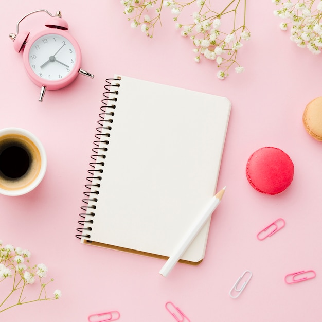 Morning office desk with coffee and stationery items Free Photo
