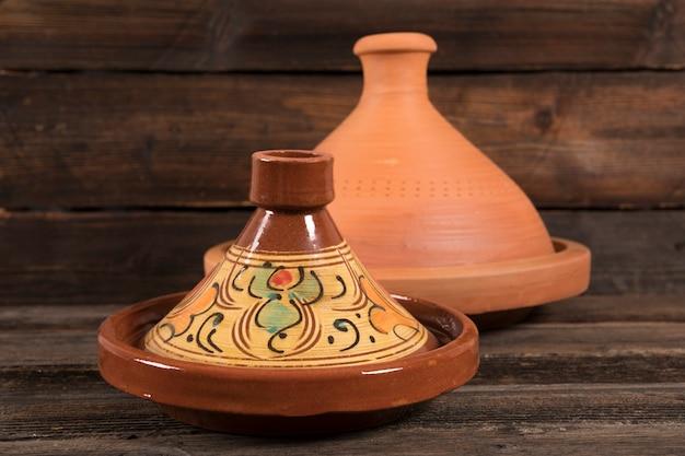 Moroccan tajines on wooden table Free Photo