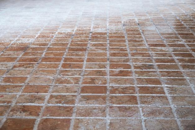 Mosaic stone floor covered with snow Premium Photo