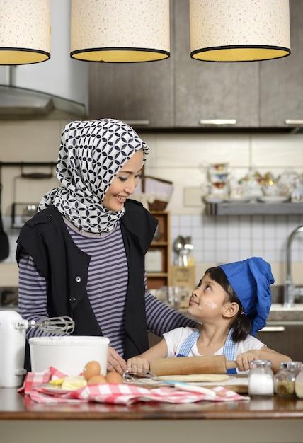 Moslem woman teaching her daughter Premium Photo