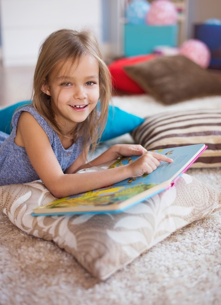 The most favourite book of little girl Free Photo
