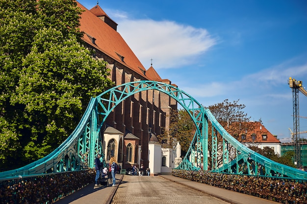 Most tumski is also called lovers, cathedral or green bridge, adorned with many love locks and hearts, wroclaw, the poland. Premium Photo
