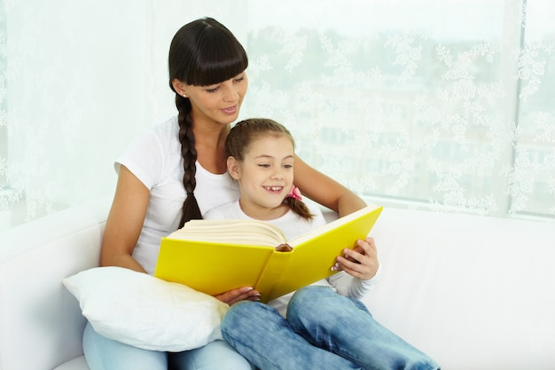 Mother and daughter reading together Free Photo