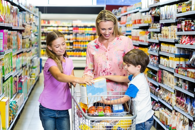 Mother and kids at the supermarket Premium Photo