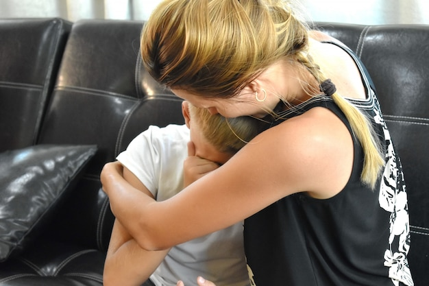 Mother comforting son. sad mother and son Premium Photo