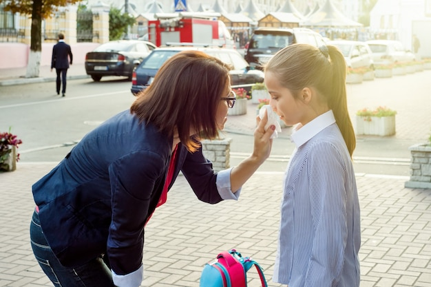 Mother consoling her crying daughter Premium Photo