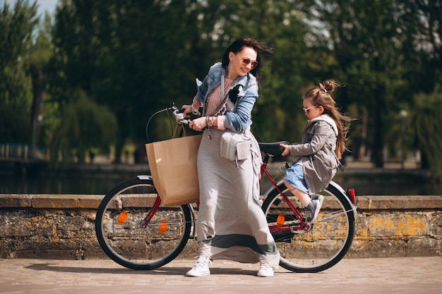 Mother and daughter bicycling Free Photo