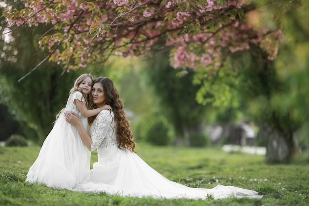 Premium Photo Mother And Daughter In The Bride S Dress Walking On The Green Grass In White Wedding Dresses,Middle Aged Outdoor Wedding Summer Wedding Guest Dresses