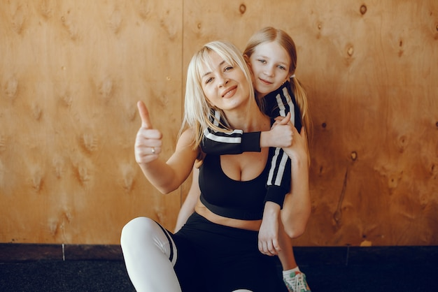 Mother and daughter doing yoga in a yoga studio Free Photo