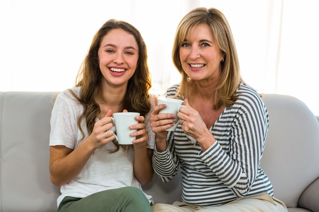 Mother and daughter drink tea at home Premium Photo