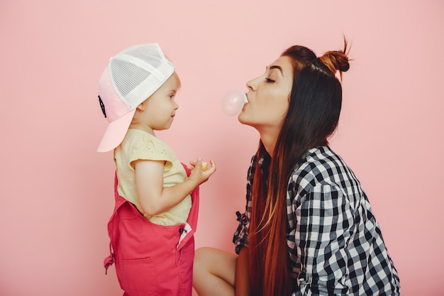 Mother and daughter have fun in a studio Free Photo
