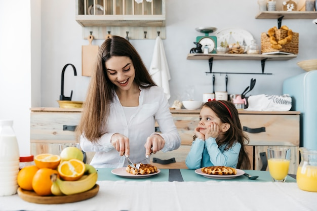 Mother and daughter having breakfast Free Photo