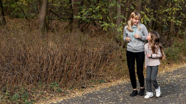 Mother and daughter jogging in nature Free Photo