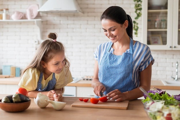 Mother and daughter in kitchen together Premium Photo