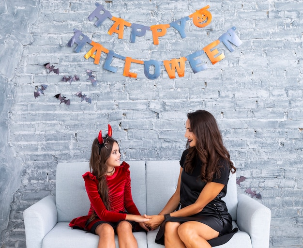 Mother and daughter posing for halloween Free Photo
