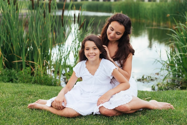 Mother and daughter posing outdoors Free Photo