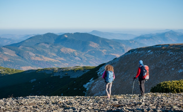 Mother and daughter standing on the ridge of the mountain Premium Photo