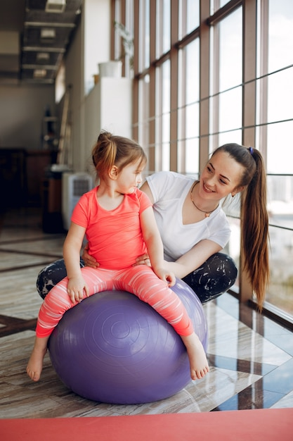 Mother and daughter training in a gym Free Photo