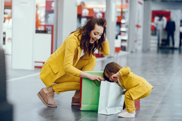 Mother and daughter with shopping bag Free Photo