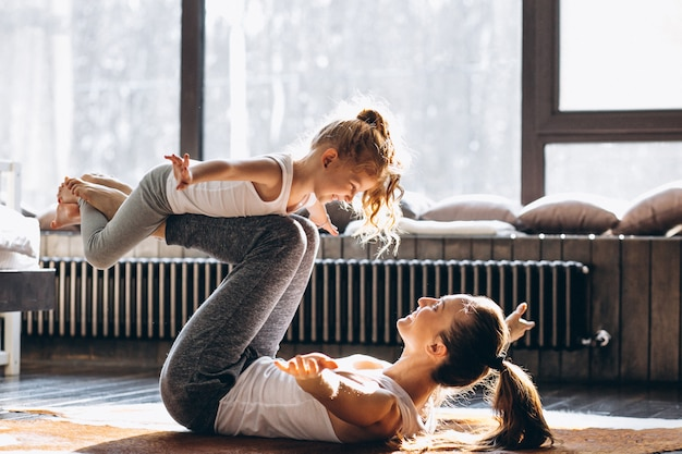 Mother and daughter yoga at home Premium Photo