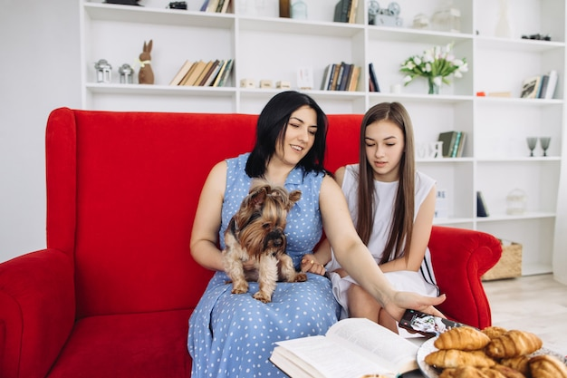 Mother and daughters resting in the living room Premium Photo