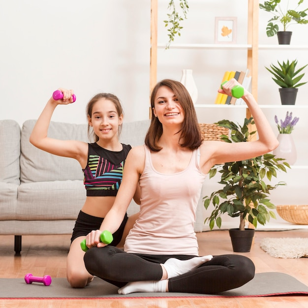 Mother and girl at home working out Free Photo
