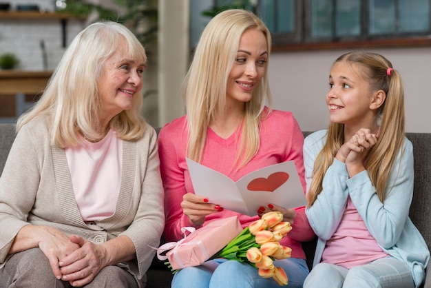 Mother and grandmother are looking at the cute girl Free Photo