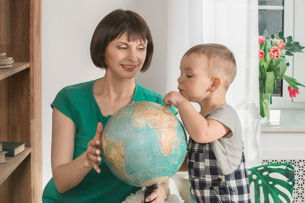 Mother and her baby are spending time in the library Premium Photo
