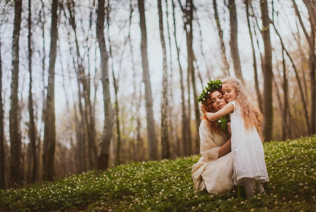 Mother hugging family lifestyle mommy Free Photo