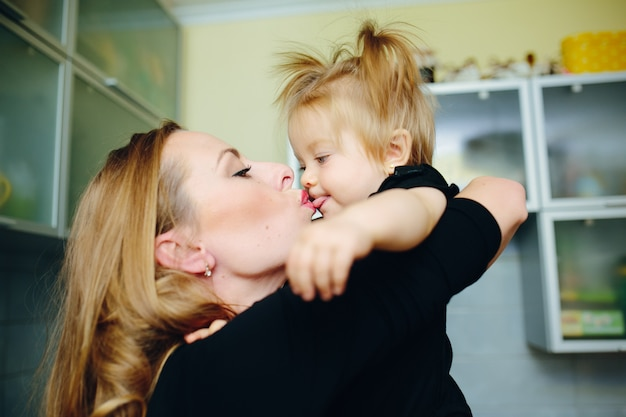 Mother kissing her daughter in the mouth Photo   Free Download