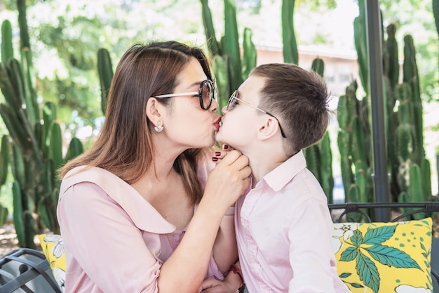 Mother kissing her son Free Photo