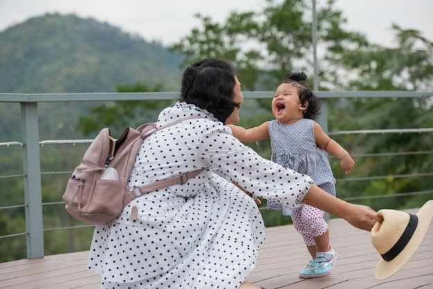 Mother and little daughter playing together in a park Free Photo