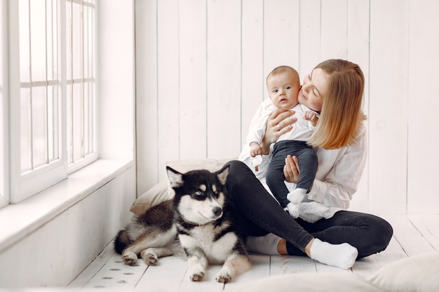 Mother and little son playing with dog at home Free Photo