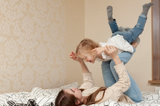 Mother playing with daughter Free Photo