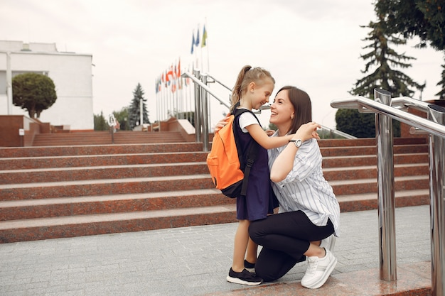 Mother prepare little daughter to school Free Photo