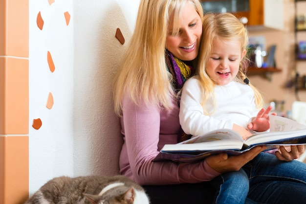 Mother reading night story to kid at home Premium Photo
