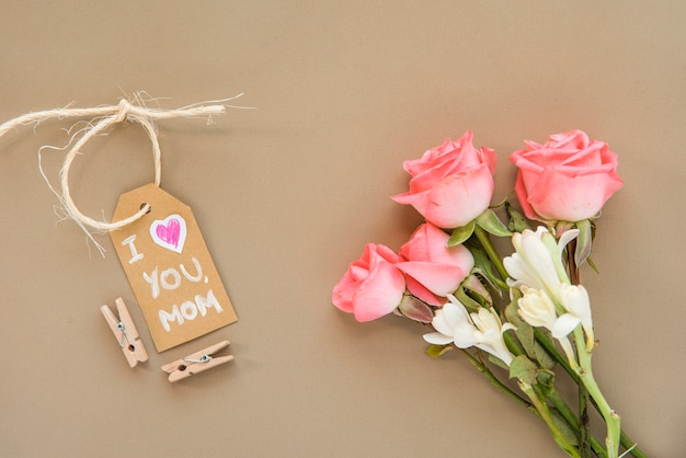 Mother`s day composition of flowers and tag Free Photo