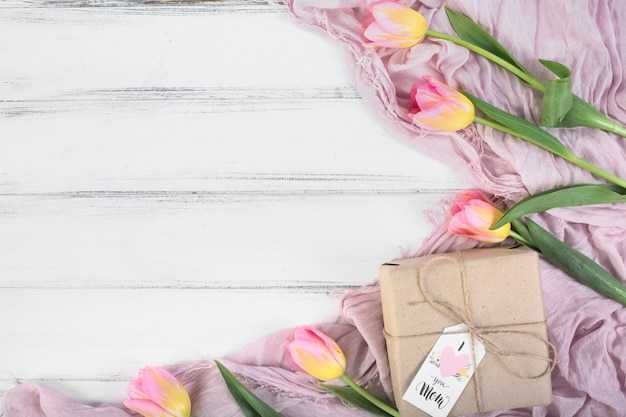Mother`s day gift box and tulips Free Photo