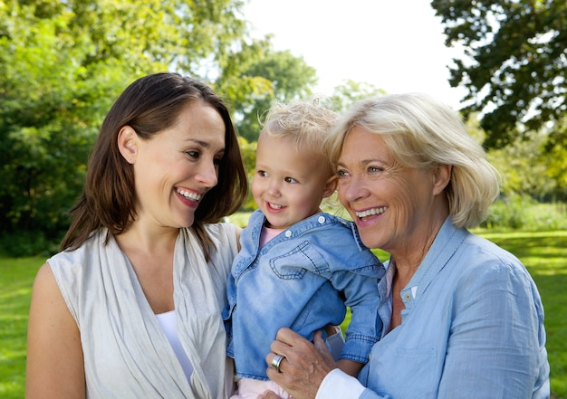 Mother smiling with baby and grandmother Premium Photo
