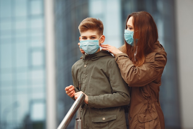 Mother and son are wearing disposable masks Free Photo