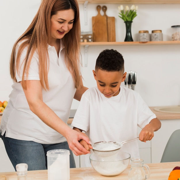 Mother and son cooking together Free Photo