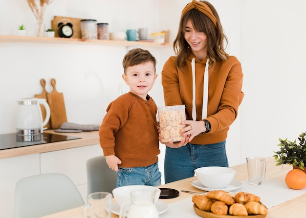 Mother and son in kitchen Free Photo