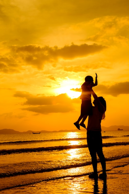 A mother and son in outdoors at sunset with copy space Free Photo