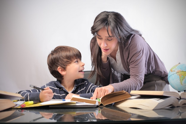 Mother and son studying Premium Photo