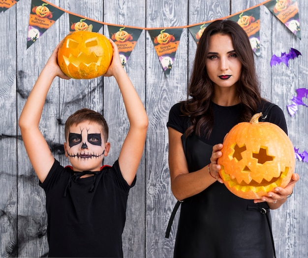 Mother and son with halloween pumpkins Free Photo