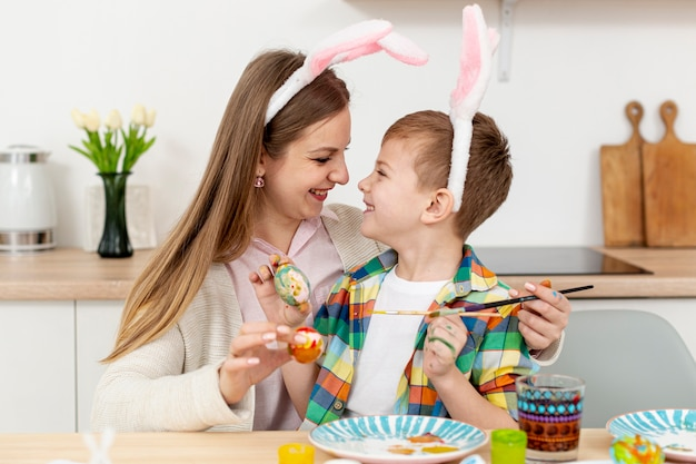 Mother and son with rabbit ears Free Photo