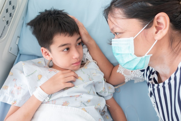 Mother take care of her son whiled he sicks in the hospital Premium Photo