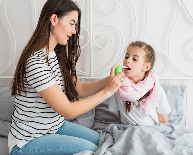 Mother taking care of her ill daughter Free Photo